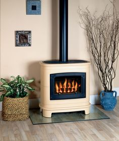 Gazco Gas Ceramica Manhattan Stove, shown with a coal fuel effect. The curved lines of the Ceramica Manhattan with its smart black and cream finish combines decorative details and enticing flames and fuel effect with the convenience of a gas stove. Electric Log Burner, Electric Fires, Stove Oven, Gas Stove, Wood Pellet Stoves, Front Room Decor, Vintage Stoves, Wood Pellets, Home