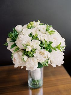 Simple and pretty white blooms with greenery for the bride's bouquet | http://www.weddingpartyapp.com/blog/2014/11/11/portland-loft-wedding-brittany-lauren-photography/
