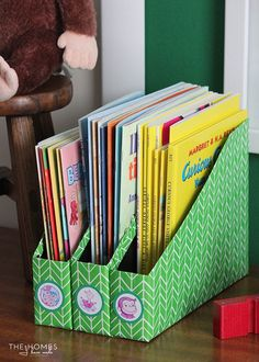 Store children's books in cereal boxes turned magazine files.  15 fun and awesome storage ideas to store children's books in play room or bedroom.  Get kids reading more.  DIY spice racks, in bin, bookshelves, without shelves.  - Organised Pretty Home #storebooks #kidsbookstorage #bookshelves #kids #reading #playroom #kidsbedroom #kidsbookstorageideas #ikea