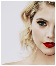 Smoky eye with a hint of a gold and bold, red lips.