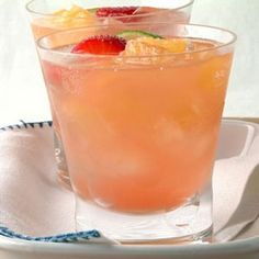Waikiki Champagne Punch  * 1.5 qt. fresh pineapple juice  * 2 - 750 ml bottles of dry or semi-dry champagne, chilled  * 3 cups of pineapple chucks in juice  * 1 lemon sliced  * 1 lime sliced  * 2 - 3 oranges sliced  * 2 cups strawberries  * ice cubes as needed