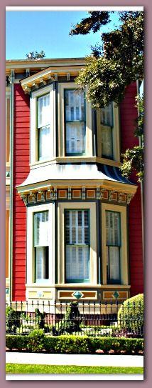 Cream windows w/ red house