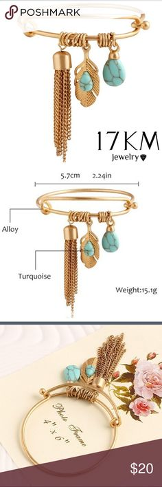 Bohemian bangle bracelet Alloy metal and turquoise make up this bracelet. Beautiful leaf and feather charms Jewelry Bracelets