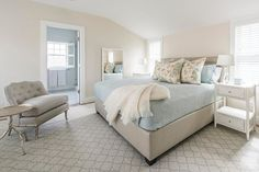 """'Whale of a Time' - Nantucket Vacation Rental. The Master King Bedroom on the second floor is complete with a sitting area (including sound system and 50"""" HD TV), his and hers closets and private bath with RainHead shower overlooking the rear patio."""