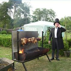 A hobbyist proudly showing off his homemade rotisserie.