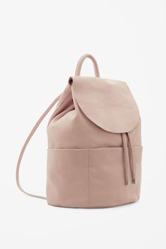 An unstructured design, this backpack is made from soft panels of leather with slim shoulder straps and drawstring fastening. Fully lined, it is completed with an inside zip pocket and raw-cut edges.