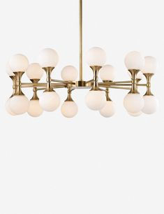 The Abernathy collection features unique glass spheres perched atop cone-shaped metal stands. Dual-light fixtures attach to spokes that meet in the center, creating a wheel-like appearance on this gorgeous chandelier.