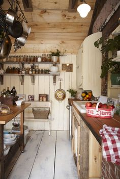 Farm kitchen. Wooden box for organizing oils, shelf for jars. whitewashing wood. inset shelving.  counters