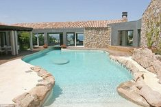 The single-storey home counts Roman Abramovich and Silvio Berlusconi as two of its neighbours