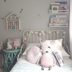 Fun garden lights on bedframe and the little house hanging for collectables is sweet too.