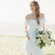 When it comes to seaside romance, this bohemian inspired wedding dress and beachy braids are what wedding dreams are made of!