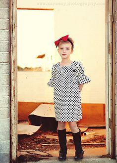 Love the modern shift dress with that big red bow . . .would look so good on my little A