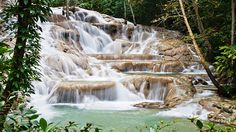 Dunn's River Falls, located near Ocho Rios, is one of the most famous tourist sites in Jamaica. Visitors can actually climb up the tiered falls on foot.