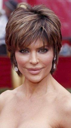 Lisa Rinna - I always liked this cut! Short mature cut with subtle highlights/lowlights and choppy bangs!A collection of the more mature hairstyles of Lisa Rinna. Lisa Deanna Rinna (born July is an American actress. Short Shaggy Haircuts, Shaggy Short Hair, Short Shag Hairstyles, Mom Hairstyles, Stacked Hairstyles, Lisa Renna Hairstyles, Pixie Haircuts, Layered Haircuts, Long Pixie