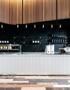 """The """"restrained opulence"""" of historic banks and treasuries informed the interior of this coffee shop in Sydney, designed by Studio Tate. #coffeeshopinteriors #coffeeshopdesign #coffeeshops"""