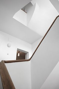 seamless stairwell with wooden banister