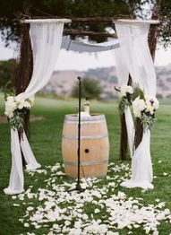 Country/wine themed ceremony decor. Colorado weddings.Green and white