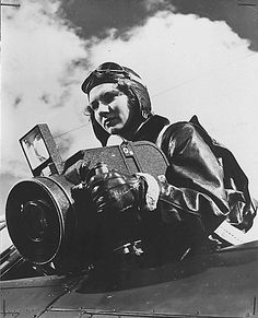 Marine Sargeant Grace L. Wyman practices aerial photography at the United States Marine Corps Air Stateion at Cherry Point in North Carolina. Aerial photography is one of the many important jobs taken over by women Marines to free men for combat duty.