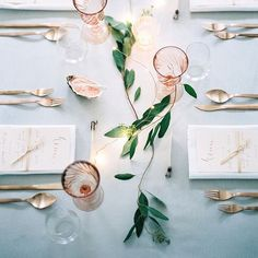 The simplicity of this table setting is the beauty... the blush pink shade of the glasses makes all the difference and enhances the simple foliage... - vicki archer // vickiarcher.com