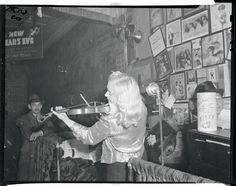 A talented woman provides entertainment at Sammy's Bowery Nightclub by playing the violin. Sammy's also came to be known as the Poor Man's 'Stork Club'. via @AOL_Lifestyle Read more: http://www.aol.com/article/finance/2016/10/06/inside-sammys-bowery-follies-the-scuzziest-greatest-dive-bar/21485297/?a_dgi=aolshare_pinterest#fullscreen
