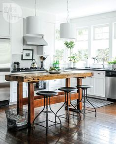 Bright kitchen with dark wooden floors and a reclaimed wooden...