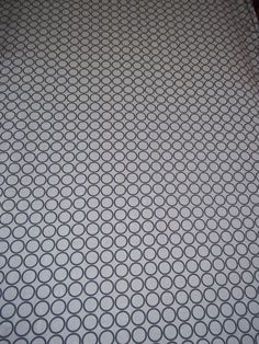 Fitted Crib sheet, Bumperless Crib bedding shown in Modern gray and white circles. $34.95, via Etsy.