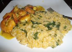 whole grain rice season with butter,spinach,squash,bouillon,thyme,salt and pepper with Jamaican style curried shrimp.