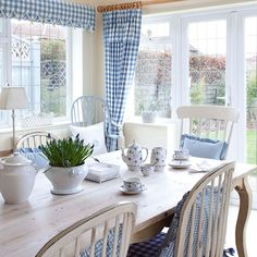 Dining room with gingham soft furnishings | Country dining room ideas | Dining room | PHOTO GALLERY | 25 Beautiful Homes | Housetohome.co.uk...