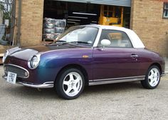 Nissan Figaro, nice looking little retro mobile, but good luck getting the U.S. DOT to let you register one in the States. Once these are 25 yrs old it will be easier to do.