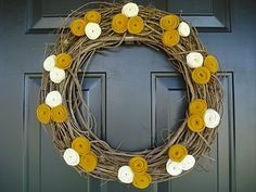 Felt Flower Wreath: Cut circles out of felt. Cut circles into spirals, roll up that spiral starting with outside edge, secure with glue on grapevine wreath.  How simple!