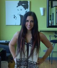 Sammie has 75 straight Dream Catchers Hair Extensions with twenty five of the dream catchers are a light red.