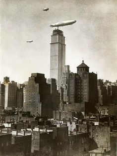 Rare archive photo of an airship mooring to the skyscraper dock while the Empire State Building was under construction.