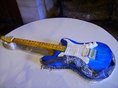 Electric Guitar cake by FairyDustCakes, via Flickr