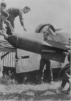 Airfield personnel extract a SC 500 bomb from the cargo-passenger compartment of the Junkers Ju Date: Source: nationaalarchief. Transport, Luftwaffe, Wwii, German, Junkers, Japanese, Airplanes, Channel, Exit Room