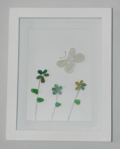 Seaham Sea Glass flowers and a butterfly.