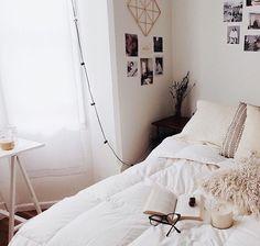 Dark wood furniture in white bedroom
