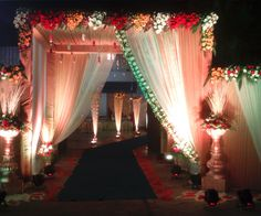 floral entrance decor , peach entrance decor , peach and white drape entrance , red , white and orange flower arrangement entrance Sikh Wedding Decor, Wedding Gate, Wedding Hall Decorations, Wedding Entrance, Wedding Mandap, Wedding Props, Diwali Decorations, Wedding Ideas, Wedding Events
