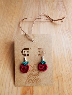 Teeny Apple Earrings Crochet Pattern Materials: #8 1.50mm Crochet Hook#10 Crochet Thread in Red#10 Crochet Thread in GreenEarring Hooks/Hardware Abbreviations: SS – Slip StitchSC – Single CrochetHDC – Half Double Crochet Instructions: Apple Chain 2.Six SC in second chain from hook. (6)Working in the round,...