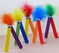 paddle pop sticks, feathers and googly eyes.