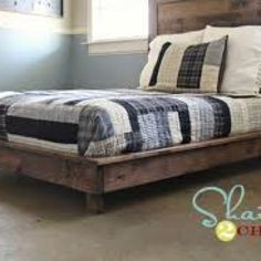 DIY bed frame. Plan and instructions here: http://ana-white.com/2012/01/plans/hailey-platform-bed