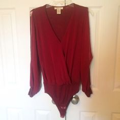 ❤️❤️ WINE RED BODYSUIT Worn once sleeves are open  **remember to bundle and save 10%** no holds/trades Arden B Tops Blouses