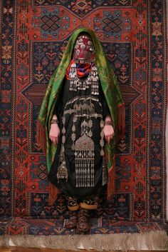 Avar woman (Caucasus), wedding traditional costume. Ethnic groups living in the Russian republic of Dagestan, village Rugudja, tribal caucasian rug, silver jewelry.