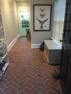Picture mudroom antique look brick tile floor