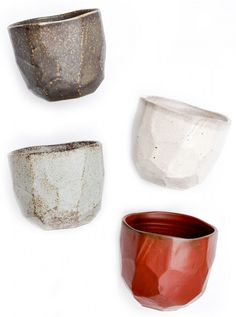 I think these are beautiful, Love the organic shape.  They are the Boulder Cup set available from MOMA museum shop.