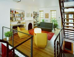 beautiful color combination with the mustard yellow, and the tomato red orange rug