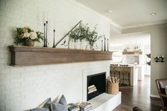 The Buftons' new family room right off the kitchen is in the perfect central location for them to gather together. This room is one that only required cosmetic updates. | from Fixer Upper, farmhouse style home decor, living room