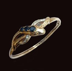 Victorian Gold Snake Bangle With Sapphires And Diamonds by AntiqueAnimalJewelry on Etsy https://www.etsy.com/listing/286228779/victorian-gold-snake-bangle-with