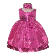 Fuchsia Baby Dress with Festive Ribbon: This fuchsia baby dress is fun and fabulous and a perfect dress for any upcoming special occasion. It boasts a light weight taffeta fabric with ribbon embroidery forming flower daisy's throughout. This gorgeous soft fuchsia baby dress also features a sleeveless design, a detachable floral bouquet on the waistline, and a crinoline enhanced skirt for extra fullness.