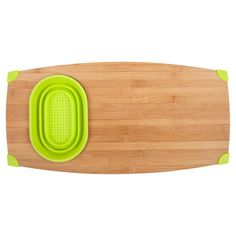 Over-the-sink cutting board with removable drain bowl and corner grips. Handcrafted of organic bamboo.  Product: Cutting boardConstruction Material: Bamboo and siliconeColor: Natural and limeFeatures: Fits directly over the kitchen sinkDimensions: .9 H x 24 W x 12 D