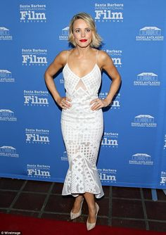 Simply stunning: The blonde was at her red carpet best with her short blonde hair worn in a loose wave